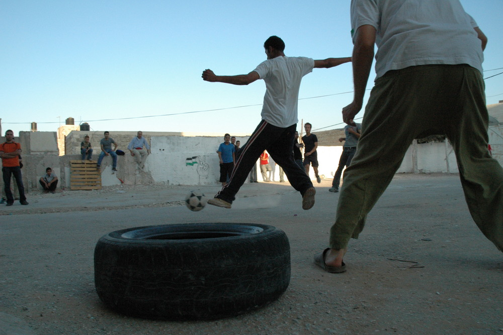 Click photo to download. Caption: Palestinians play soccer in the West Bank. Credit: Justin McIntosh via Wikimedia Commons.