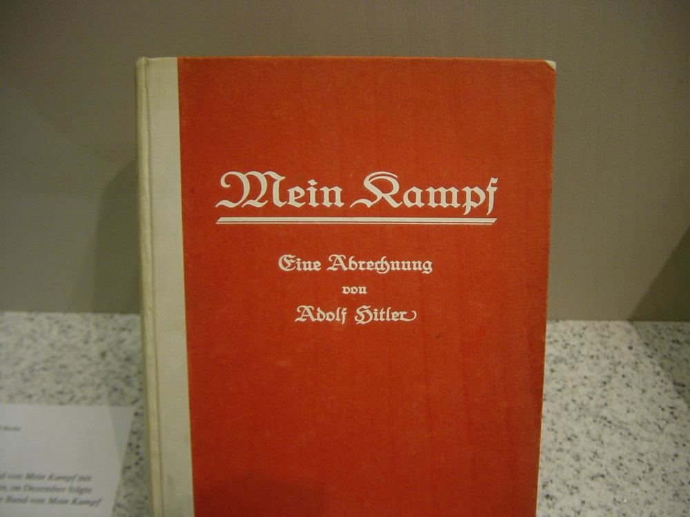 "Click photo to download. Caption: The first edition of Adolf Hitler's book, ""Mein Kampf,"" at an exhibit of the German Historical Museum in Berlin. Credit: Anton Huttenlocher via Wikimedia Commons."