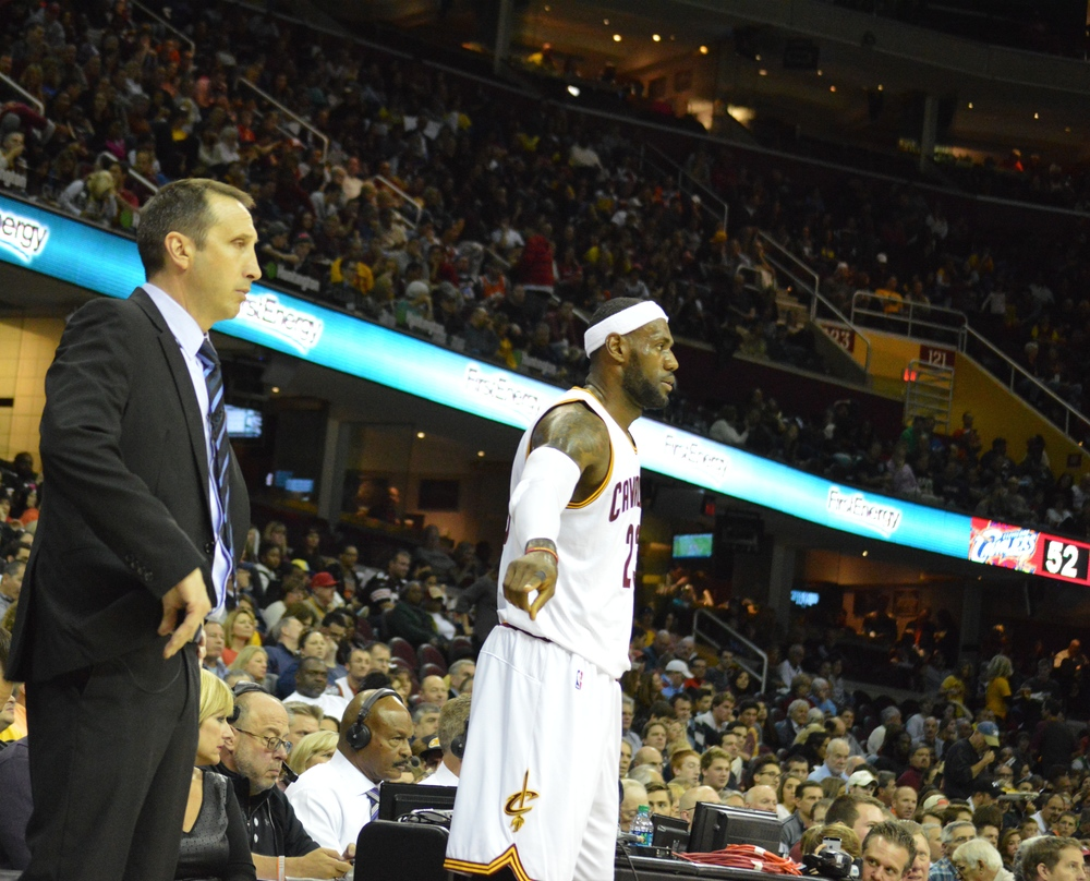 Click photo to download. Caption: Cleveland Cavaliers Head Coach David Blatt (left) and NBA superstar LeBron James (center). Credit: Bob Jacob.