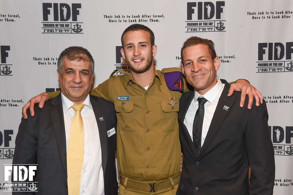 "Click photo to download. Caption: From left to right, Friends of the Israel Defense Forces (FIDF) National Director and CEO Maj. Gen. (Res.) Meir Klifi-Amir, lone soldier Sgt. Sahar Elbaz, and FIDF San Diego Chapter Executive Director Nir BenZvi. Elbaz says of his IDF experience, ""The morals and values they instill in you are top-notch."" Credit: Shahar Azran."