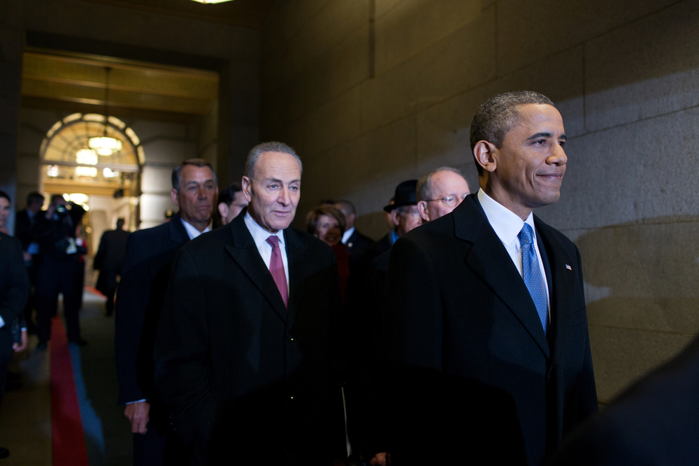 U.S. Sen. Chuck Schumer (D-N.Y., pictured in center) supports a bill that would mandate Congressional review of a final nuclear deal with Iran. President Barack Obama (far right), after previously vowing to veto the bill, is reportedly likely to approve a modified version. Credit: Pete Souza/White House.