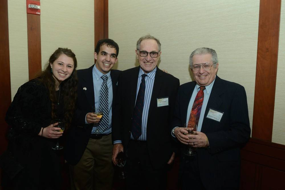 Click photo to download. Caption: Justin Hayet (second from left) with famed attorney Alan Dershowitz (third from left). Credit: Courtesy Justin Hayet.