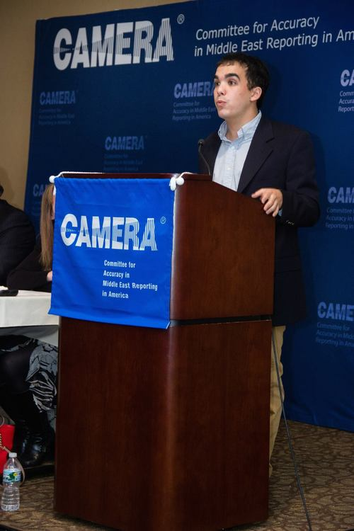 Click photo to download. Caption: Justin Hayet speaks at an event of the Committee for Accuracy in Middle East Reporting in America (CAMERA). Credit: CAMERA.
