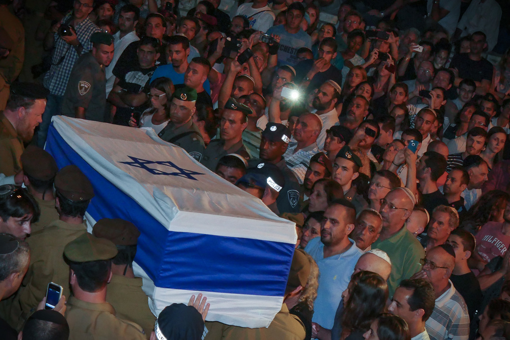 Click photo to download. Caption: Thousands of Israelis attend the funeral of Israel Defense Forces lone soldier Nissim Sean Carmeli, who was from Texas, at the military cemetery in Haifa on July 21, 2014. Credit: Flash90.