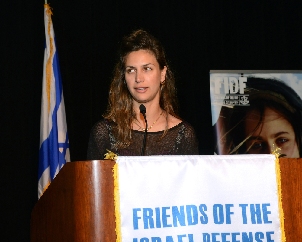 Click photo to download. Caption: Gal Carmeli, sister of the late lone soldier Nissim Sean Carmeli, speaks at the April 27 Friends of the Israel Defense Forces (FIDF) Texas Chapter gala. Credit: Alan Ross.