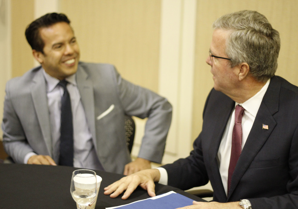 Click photo to download. Caption: Rev. Samuel Rodriguez (left), president of the National Hispanic Christian Leadership Conference (NHCLC)/CONEL, with former Florida governor and expected presidential candidate Jeb Bush at the NHCLC/CONEL convention in Houston. When Bush addressed the convention, he received the loudest applause for his remarks on Israel. Credit: Carlos Campos.