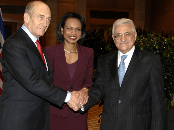 Ex-Israeli prime minister Ehud Olmert meets with Condoleezza Rice and Mahmoud Abbas in 2007. Credit: Matty Stern/State Department photo.