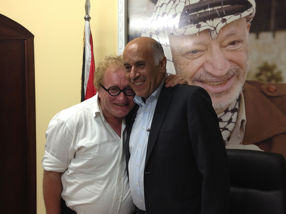 Click photo to download. Caption: Tuvia Tenenbom (left) with Jibril Rajoub, former head of the Palestinian Authority's intelligence and security apparatus, in Ramallah. Behind them is a photo of Yasser Arafat. Credit: Gefen Publishing.