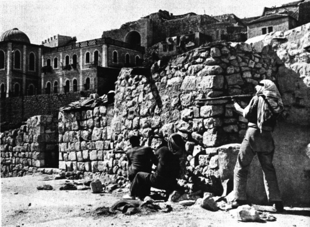 Click photo to download. Caption: The Arab Legion attacking the Jewish Quarter of Jerusalem in May 1948. Credit: John Phillips for Life Magazine via Wikimedia Commons.