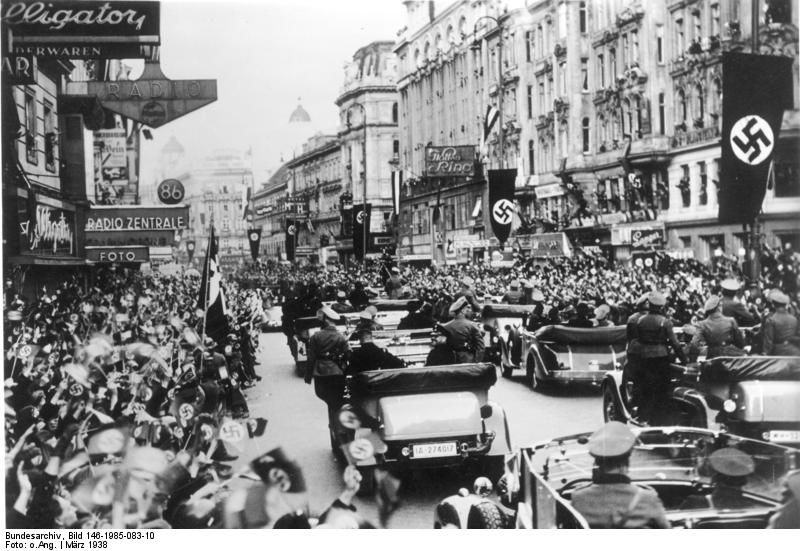 Cheering crowds greet the Nazis in Vienna, Austria after the country joins the Third Reich in 1938 in what has become known as the Anschluss. Credit: German National Archive via Wikimedia Commons.