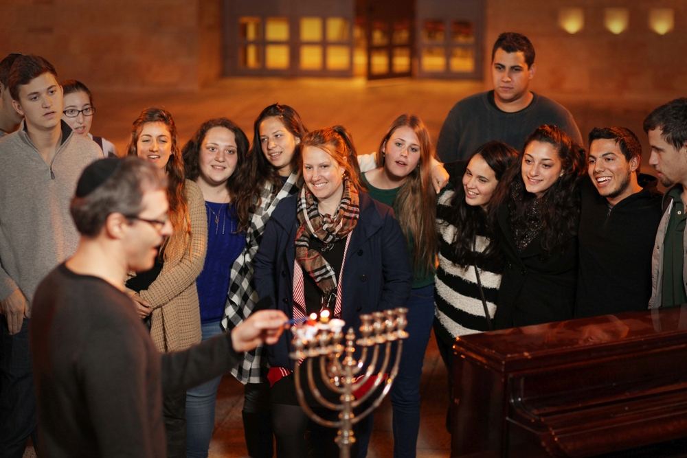 Click photo to download. Caption: Hevruta program participants celebrate Hanukkah. Credit: Courtesy of the Shalom Hartman Institute.