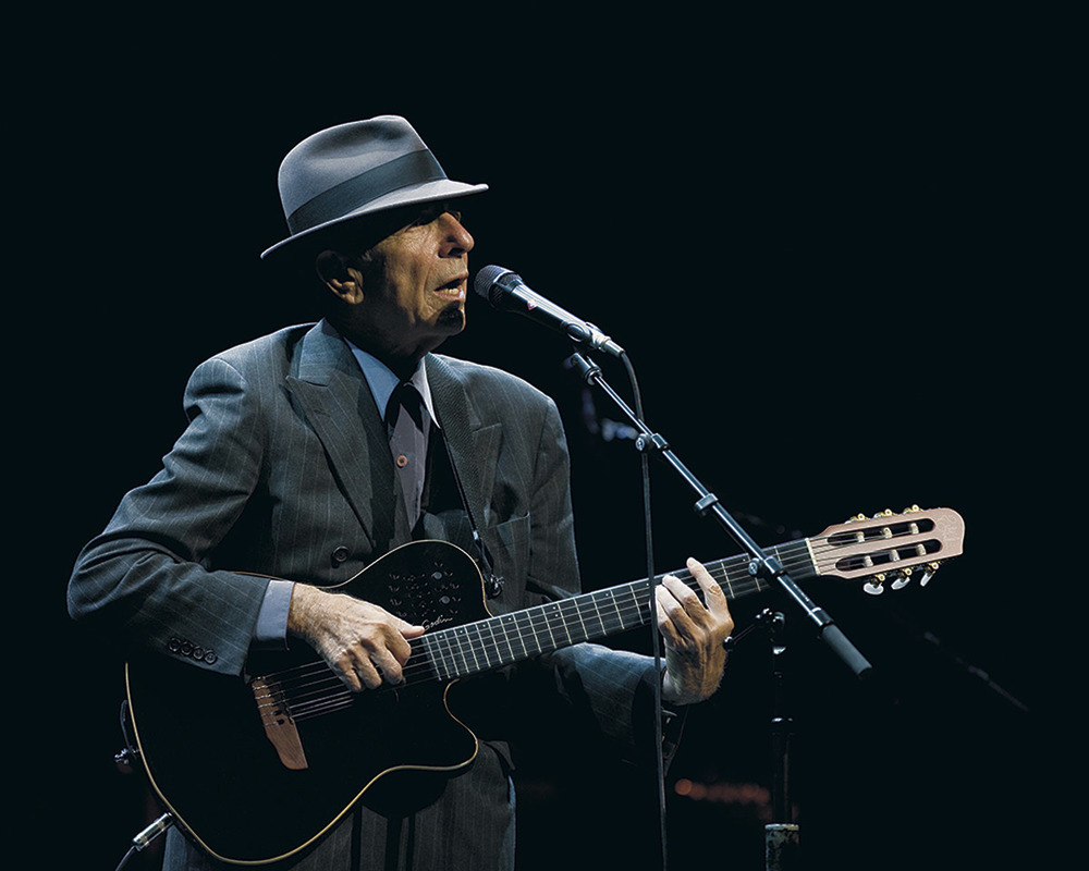 Click photo to download. Caption: Leonard Cohen in concert. Credit: Leonard Cohen press photo.