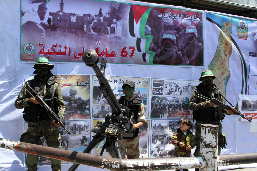 Click photo to download. Caption: Hamas terrorists participate in a militaristic rally against Israel in the southern Gaza Strip on May 17, 2015. With the emergence of Islamic State supporters in Gaza, Hamas has a new rival in the territory in governs. Credit: Abed Rahim Khatib/Flash 90.