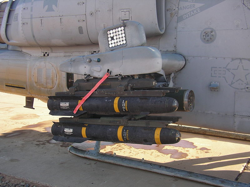 Hellfire missiles—which are part of the newly proposed U.S. military aid package for Israel—are loaded onto the rails of a United States Marine Corps AH-1W Super Cobra at Balad Air Base in Iraq in 2005. Credit: Looper5920 via Wikimedia Commons.