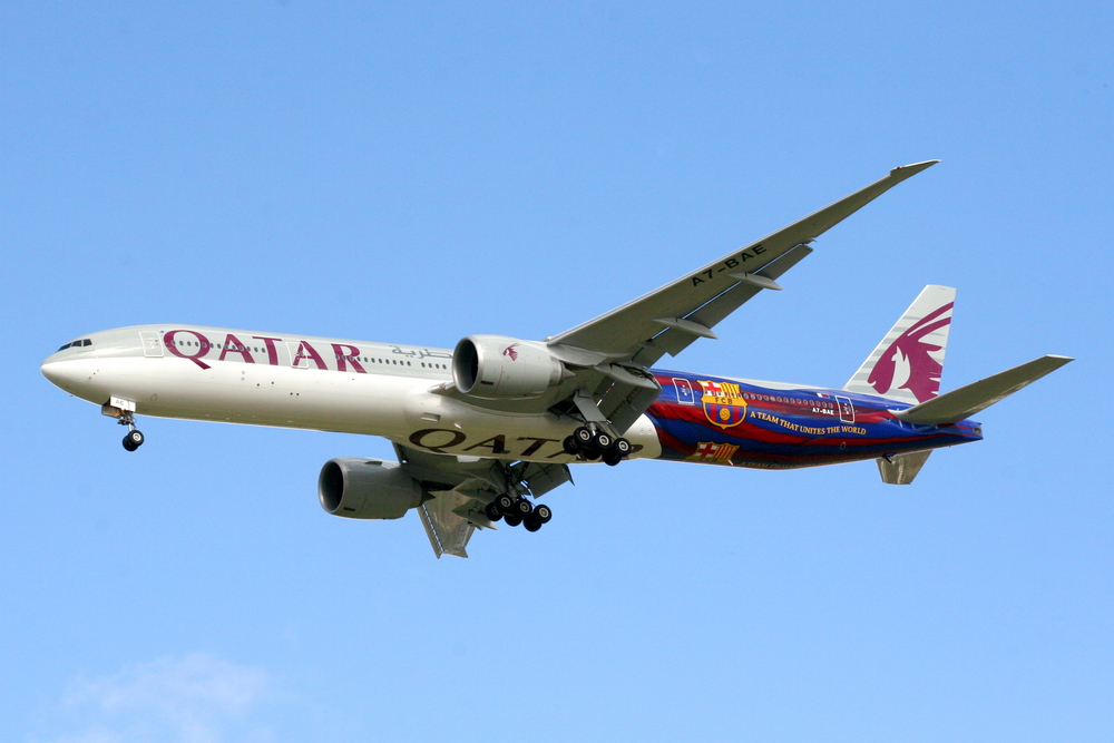 Click photo to download. Caption: A Qatar Airways plane that in its back half bears the logo of Spain's FC Barcelona soccer team, indicative of the close relationship between European soccer clubs and Qatari coffers. Credit: John Taggart via Wikimedia Commons.
