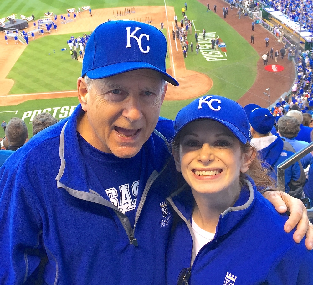 Click photo to download. Caption: John Shuchart with his daughter Carrie at a Kansas City Royals baseball game. Credit: Courtesy John Shuchart.