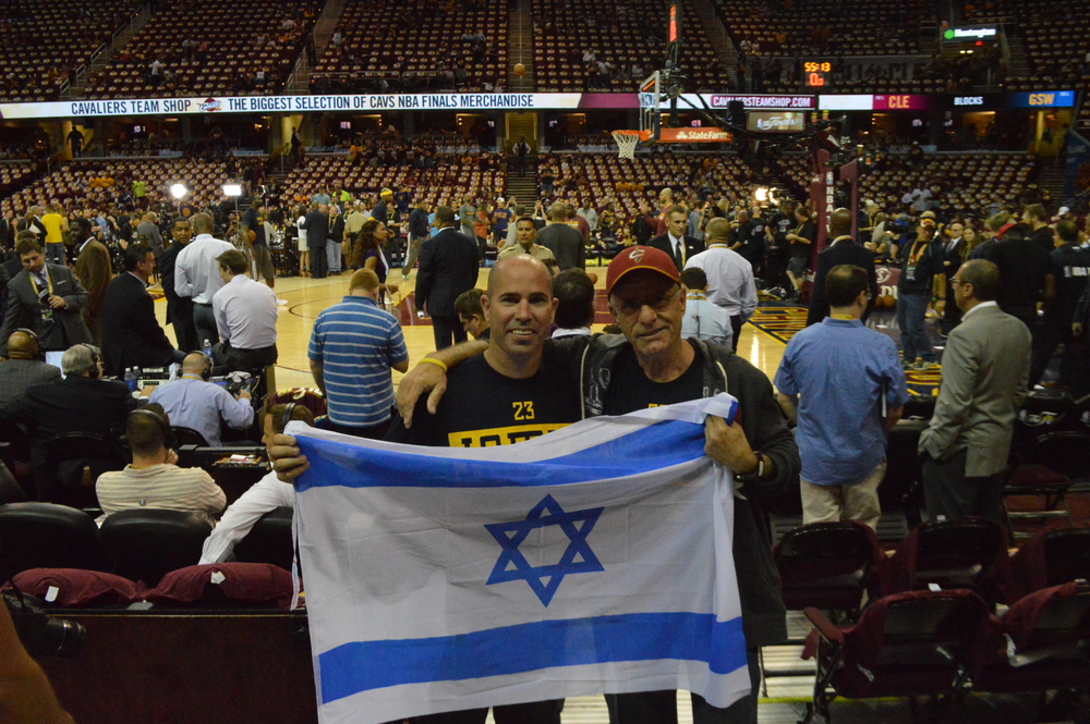 Click photo to download. Caption: Tomer Hulli (left) and his father, Eli, came from Israel to watch the Cleveland Cavaliers defeat the Golden State Warriors 96-91 in Game 3 of the NBA Finals on June 9 at Quicken Loans Arena in downtown Cleveland. Credit: Bob Jacob.