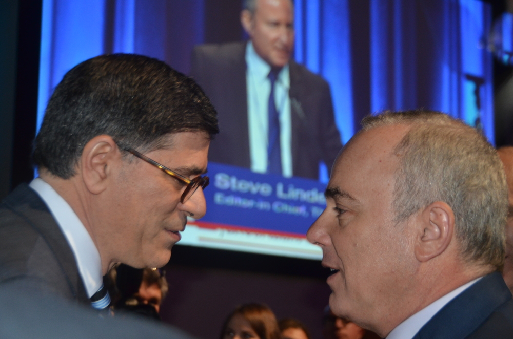 Click photo to download. caption: U.S. Secretary of the Treasury Jack Lew (left) and Israeli Energy Minister Yuval Steinitz(right) were among the major speakers at the June 7Jerusalem Post-hostedconference in New York City. In the background, seen speaking on the projector screen, isJerusalem PostEditor-in-Chief Steve Linde. Credit: Maxine Dovere.