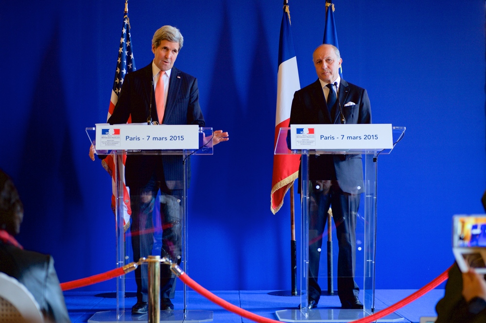 Click photo to download. Caption: U.S. Secretary of State John Kerry (left) addresses reporters during a joint news conference with French Foreign Minister Laurent Fabius (right) in Paris on March 7, 2015, following a bilateral meeting focused on the nuclear negotiations with Iran and other regional issues. Credit: U.S. State Department.