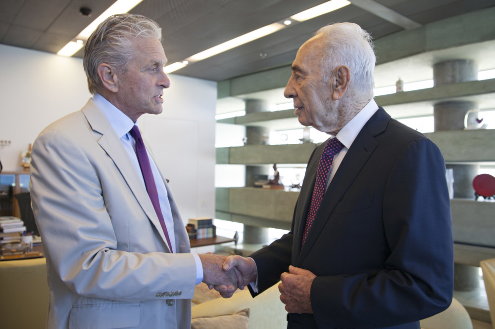 Actor Michael Douglas (left) meets with former Israeli president Shimon Peres this week in Tel Aviv. Credit: Peres Center for Peace.