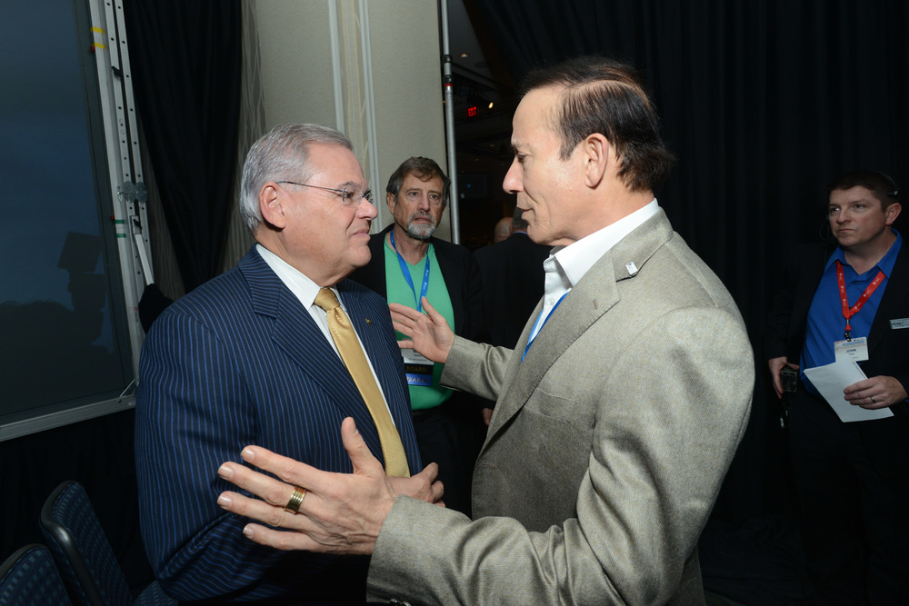 "Click photo to download. Caption: U.S. Sen. Robert Menendez (D-NJ, pictured at left) with Jewish philanthropist Adam Milstein (at right) during the Israeli-American Council national conference in Washington, DC, in November 2014. Milstein says he is ""constantly changing"" his philanthropy ""based on the facts on the ground."" Credit: Shahar Azran."