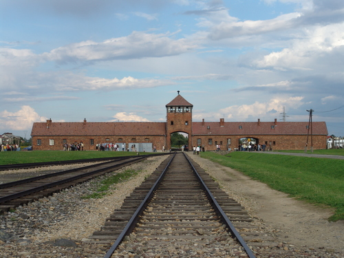 Click photo to download. Caption: The railway leading up to the main gate at the Nazis' former Auschwitz II (Birkenau) concentration camp. Credit: Michel Zacharz via Wikimedia Commons.