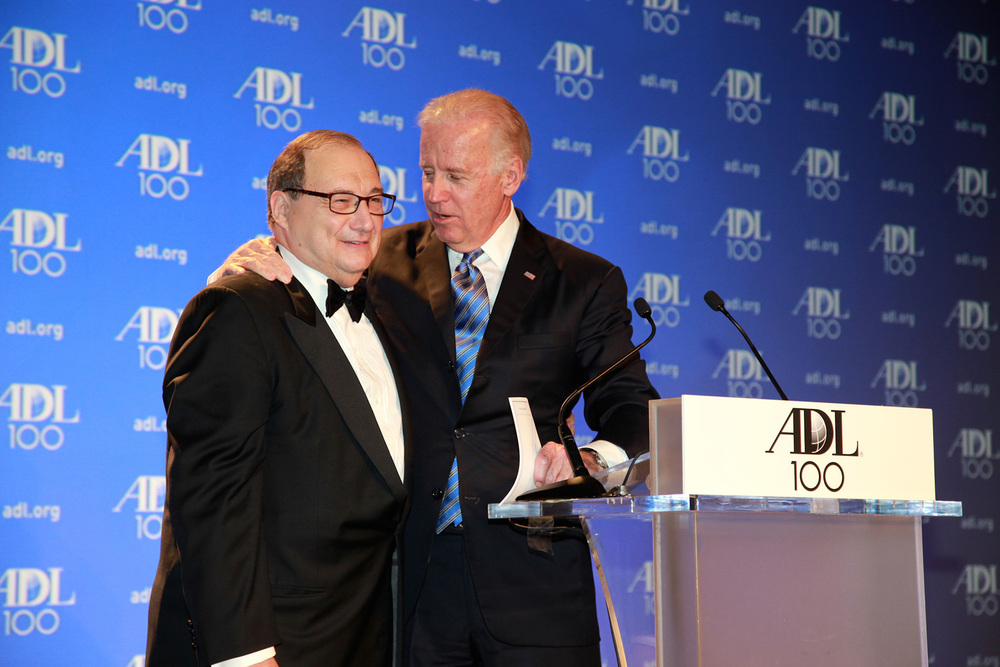 "Click photo to download. Caption: U.S. Vice President Joe Biden (right) sings ""happy birthday"" to Abraham Foxman (left), national director of the Anti-Defamation League (ADL), at the ADL's Centennial Gala in April 2013 in Washington, DC. Foxman recently claimed that Michael Oren ""veers into the realm of conspiracy theories"" in the latter's analysis of U.S. President Barack Obama's roots. Credit. David Karp."