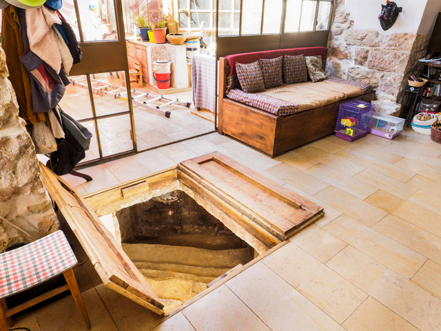 The living room of a Jerusalem home where a 2,000-year-old Jewish ritual bath was discovered under the floor. Credit: Israel Antiquities Authority.