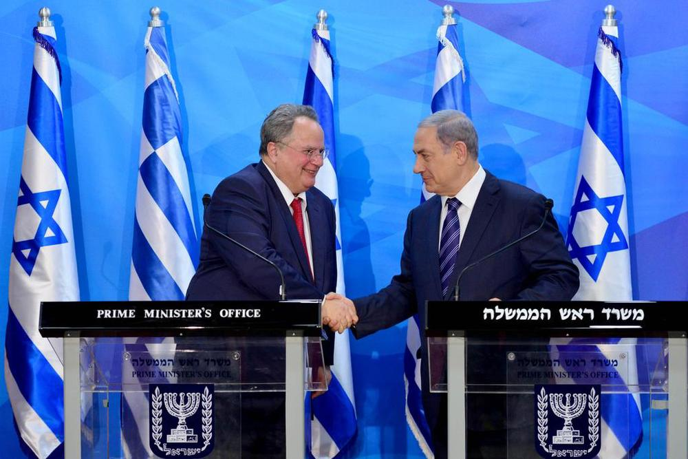 Israeli Prime Minister Benjamin Netanyahu (right) meets with Greek Foreign Minister Nikos Kotzias in Jerusalem on Monday. Credit: Israeli Prime Minister's Office.