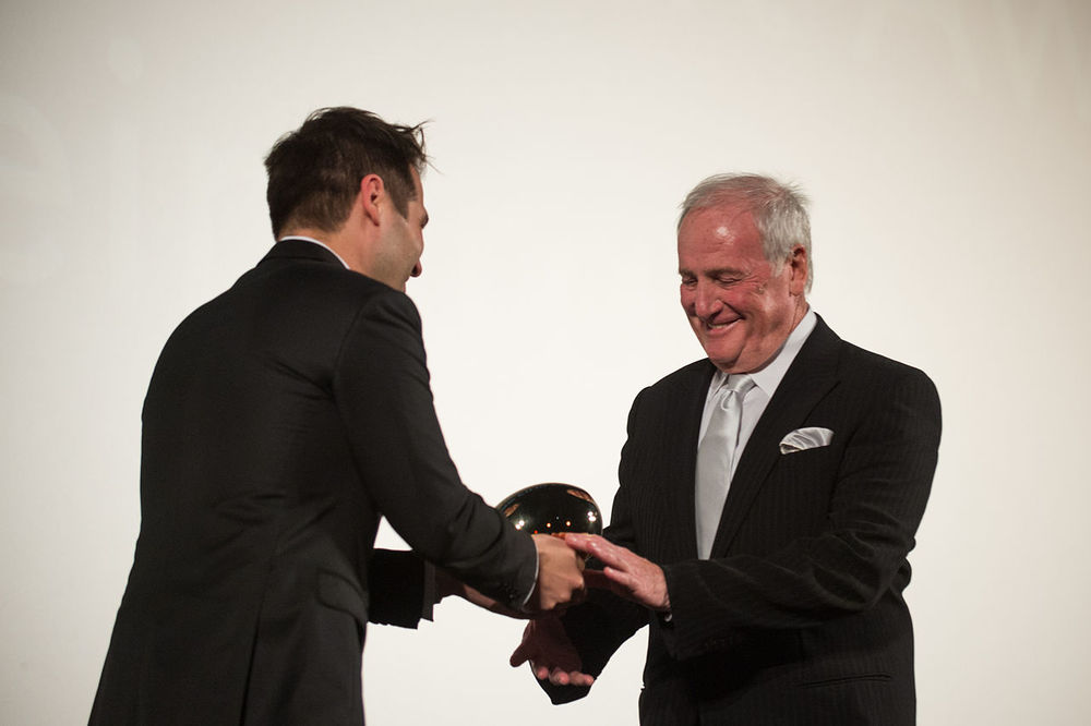 Producer Jerry Weintraub (right) receives a Career Achievement Award in 2012. Credit: Wikimedia Commons.