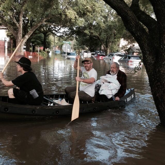 Morgan Davies (far left) and Donniel Ogorek (center) rescueRabbi Joseph Radinsky (right) from May'sflood in Houston. Credit: Robert Levy via Facebook.