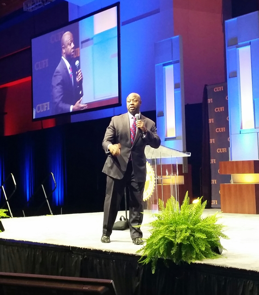Click photo to download. Caption: U.S. Sen. Tim Scott (D-Hawaii) addresses the Christians United for Israel Washington Summit on Tuesday, following that morning's announcement of a nuclear deal between Iran and world powers. Credit: Paul Miller.