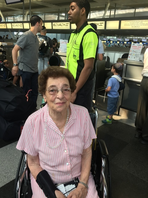 Click photo to download. Caption: Sue Friedman, 90, at New York's John F. Kennedy International Airport before boarding the 53rd Nefesh B'Nefesh aliyah flight. Credit: Maayan Jaffe.