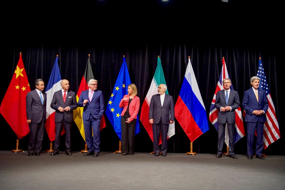 Click photo to download. Caption: U.S. Secretary of State John Kerry (far right) poses with his P5+1 and Iranian negotiating partners in Vienna, Austria, on July 14, shortly after the formal announcement of a nuclear deal between Iran and world powers. Credit: U.S. Department of State.