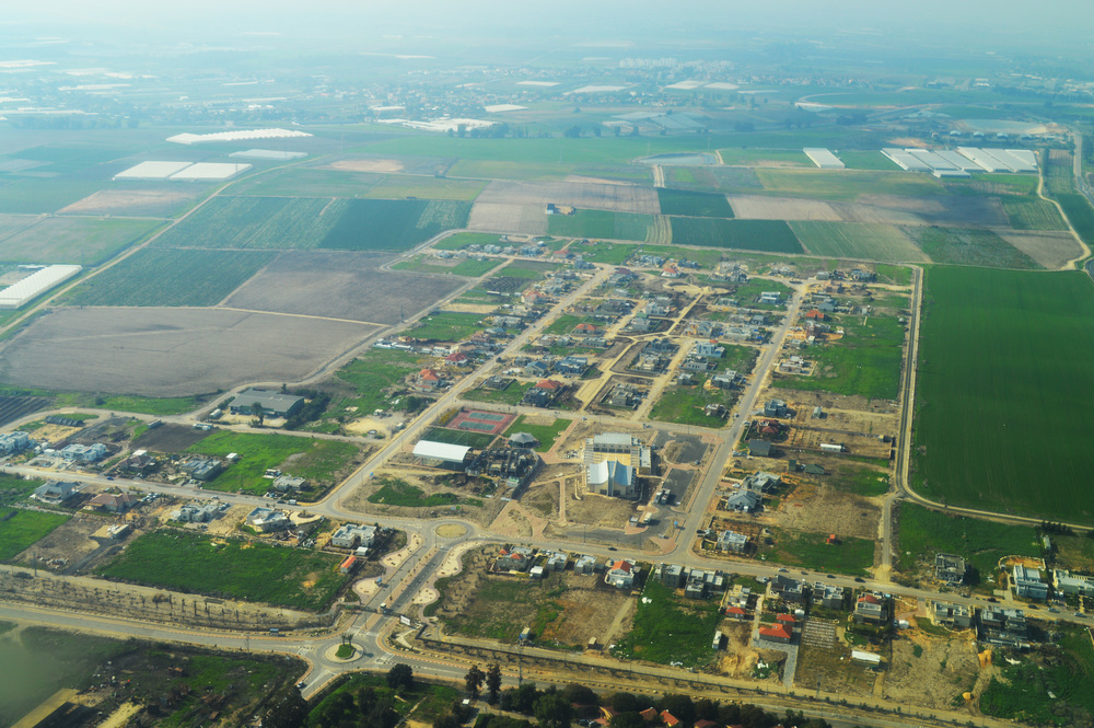 Click photo to download. Caption: An aerial view of the re-established Gannei Tal community in southern Israel. Eldad Galed lived in the now-destroyed version of Gannei Tal in Gaza before Israel's unilateral disengagement from the area in 2005. Credit: Amos Meron via Wikimedia Commons.