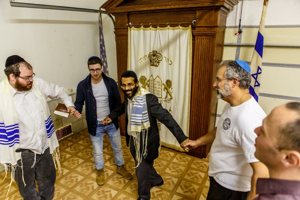 "Rabbi Shimon Grady (pictured in center) dances with community members at the ""sanctuary"" he leads on Maryland's lower eastern shore. Credit: Courtesy Rabbi Shimon Grady."