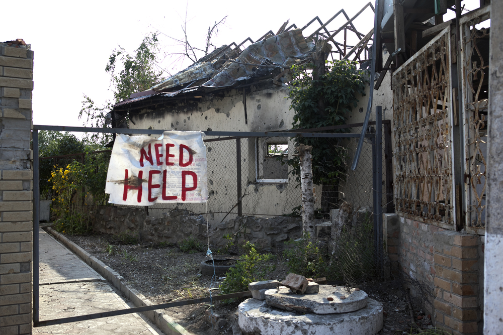 Click photo to download. Caption: A plea for help in conflict-ravaged Ukraine. Credit: Courtesy JDC.