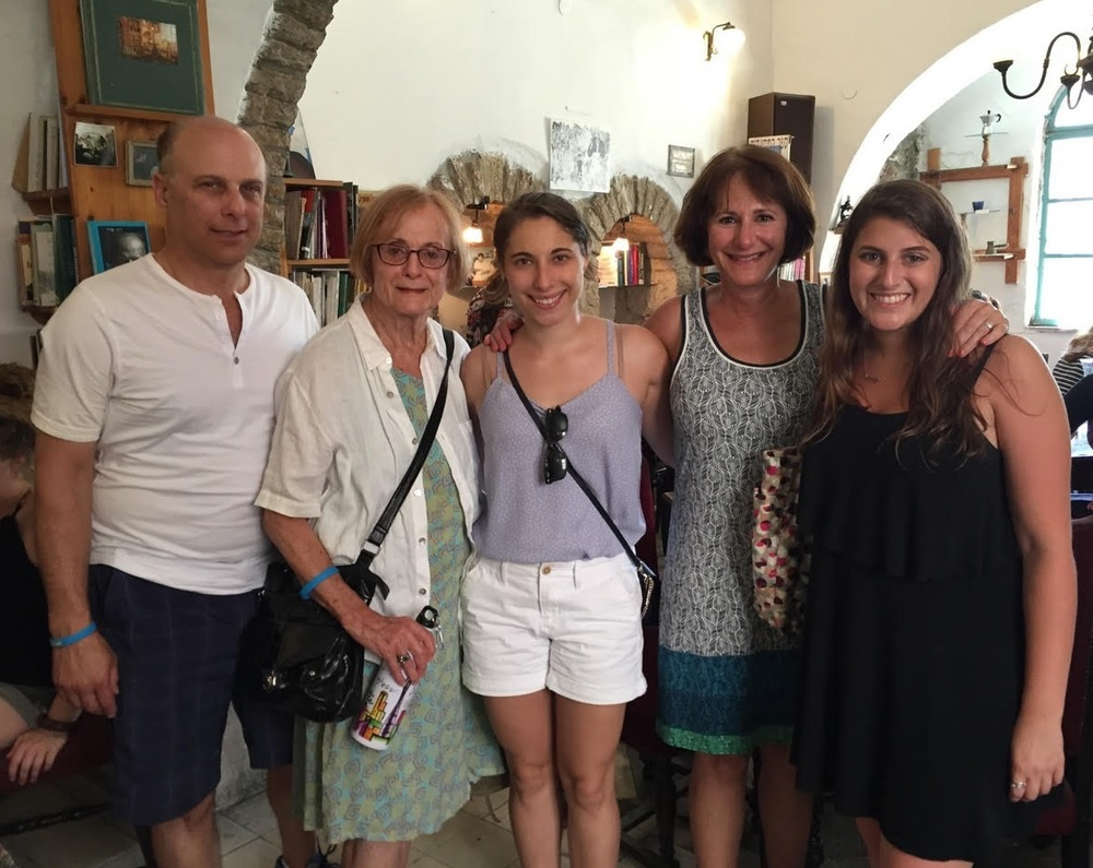 Click photo to download. Caption: In Israel, Eliana Rudee (center) is pictured with her father (far left), grandmother, mother, and a friend who also made aliyah. Credit: Christa Lilly.