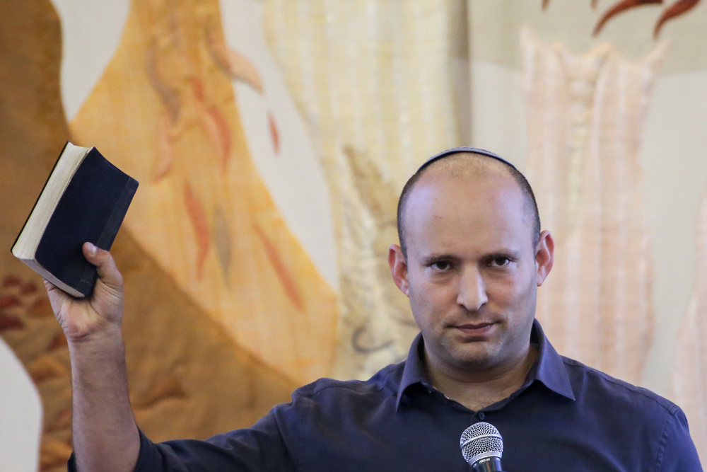 Click photo to download. Caption: Israeli Minister of Education Naftali Bennett speaks during a visit to a bible study seminar at the Herzog College in the West Bank Jewish settlement of Alon Shvut on July 20, 2015. Credit: Gershon Elinson/Flash90.