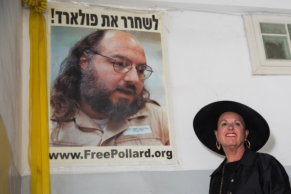 Click photo to download. Caption: Esther Pollard walks past a poster of her husband, Jonathan Pollard, before speaking to reporters outside of her Jerusalem home on July 29, the day after it was announced that Jonathan, jailed for nearly 30 years over giving Israel classified information on America, will be released in November. Credit: Flash90.