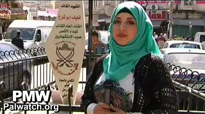Clock photo to download. Caption: The mother of Palestinian terrorist Naif Abu Sharakh is pictured next to a new monument in a Nablus city square that was renamed after her son. Credit: Palestinian Media Watch.