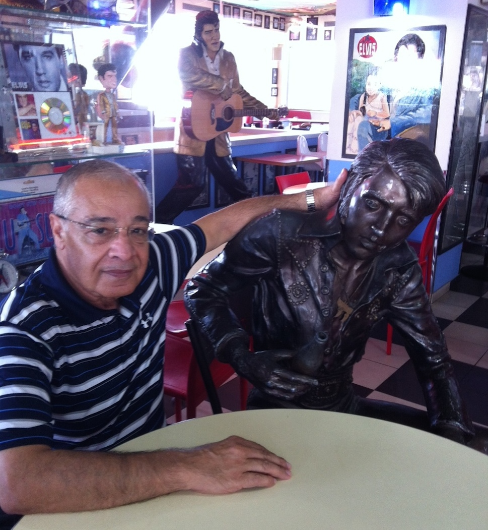 Click photo to download. Caption: Uri Yoeli (left) at the Elvis Inn, his restaurant/convenience store/gas station in Neve Ilan, Israel. Credit: Deborah Fineblum Schabb.