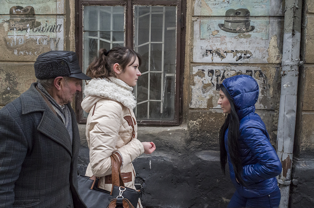 Click photo to download. Caption: In Lviv, Ukraine, it's not uncommon to spot faded Hebrew letters on the exterior of buildings, as is the case at right in this photo. Credit: Jason Francisco.