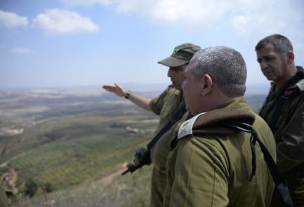 IDF Chief of Staff Lt. Gen. Gadi Eizenkot looks over the Israel-Syria border on Wednesday. Credit: IDF Spokesperson's Unit.