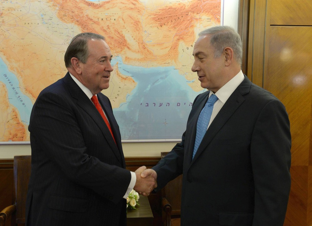 Click photo to download. Caption: Republican presidential candidate Mike Huckabee (left) meets Israeli Prime Minister Benjamin Netanyahu in August in Israel. Credit: Israeli Prime Minister's Office.