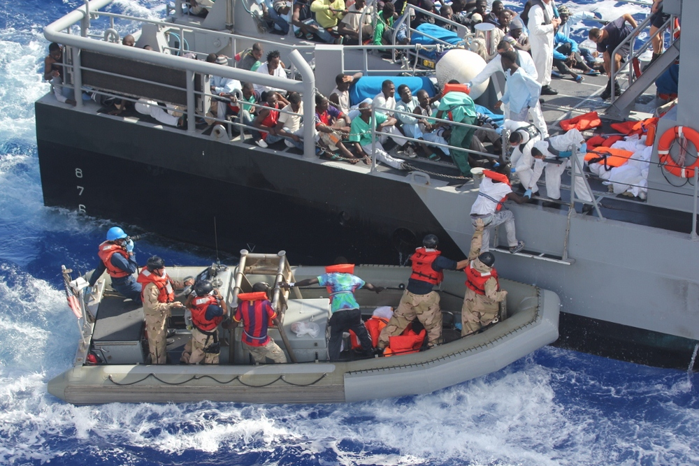 Rescued migrants off the coast of Malta in 2013. The EU has been dealing with a large influx of migrants escaping war-torn countries in the Middle East and Africa, which has substantially escalated in recent weeks. Credit: U.S. Navy via Wikimedia Commons.