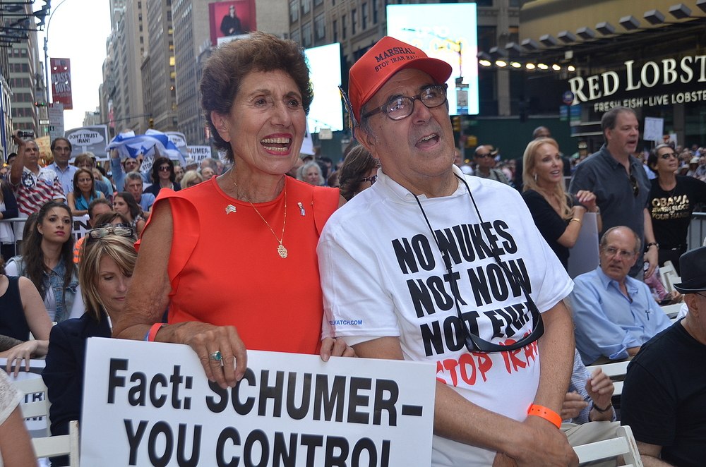 Click photo to download. Caption: Pictured in front, Helen Freedman, director of Americans for a Safe Israel, with Charles Bernhardt at a July 22 rally against the Iran deal in New York City. The sign held by Freedman targets the vote of U.S. Sen. Chuck Schumer (D-N.Y.), who later announced he would oppose the deal. But the Senate will fall short of producing the 67 anti-deal votes needed to override a presidential veto of its collective decision. Credit: Maxine Dovere.