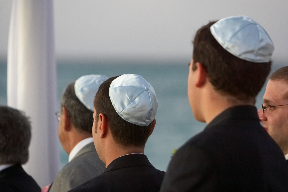 A new survey says that 70 percent of European Jews will likely avoid wearing identifying Jewish symbols, such as the yarmulke, in public out of fear of anti-Semitic harassment or violence. Credit: Wikimedia Commons.