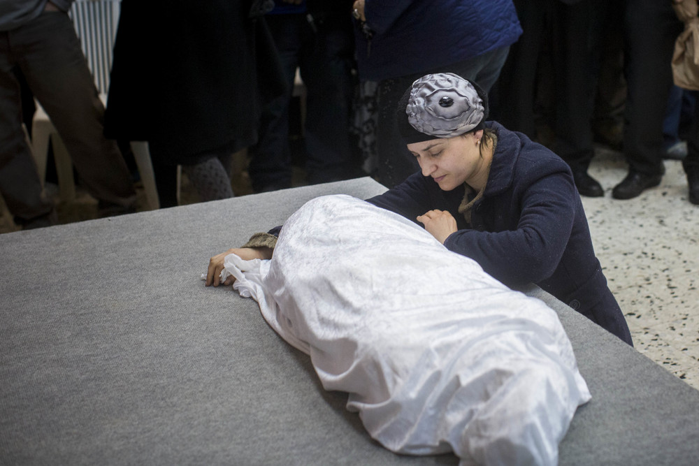 Click photo to download. Caption: Adva Biton—mother of Adele Biton, a 4-year-old Israeli Jewish victim of a Palestinian rock-throwing terror attack—cries over her daughter's body in February 2015. Credit: Yonatan Sindel/Flash90.