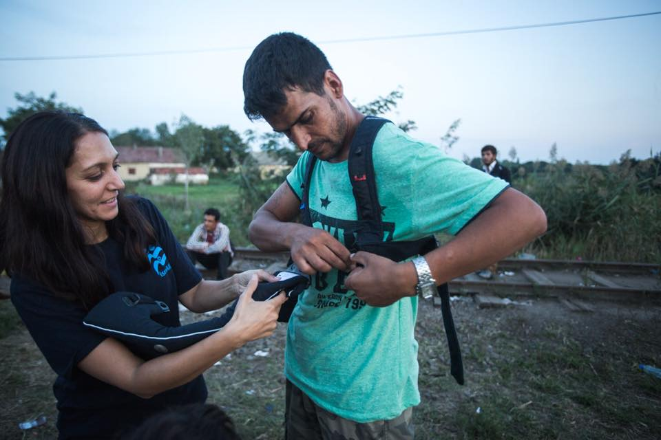 IsraAID has provided baby carriers to refugee families with babies on the Serbia-Hungary border. Credit: IsraAID via Facebook.